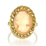 An antique carved cameo ring in 18ct yellow gold carved to depict the bust of a lady within a