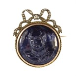 A French sapphire cameo and diamond brooch in gold and silver set with a large, circular carved blue