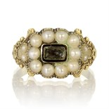 An antique Georgian hairwork and pearl mourning ring in 18ct yellow gold set with a central