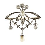 An antique Belle Epoque natural pearl and diamond brooch in gold and silver or platinum, set with