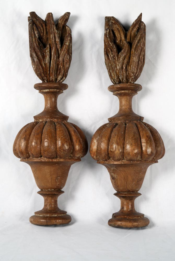 A beautifully carved urn form wood wall applique with