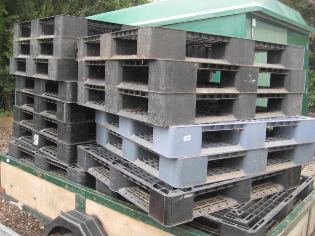 Quantity of black GRP plastic pallets
