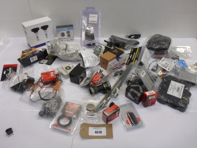 Car and bike related products including inner tubes, spark plug resistor boots, head lights,