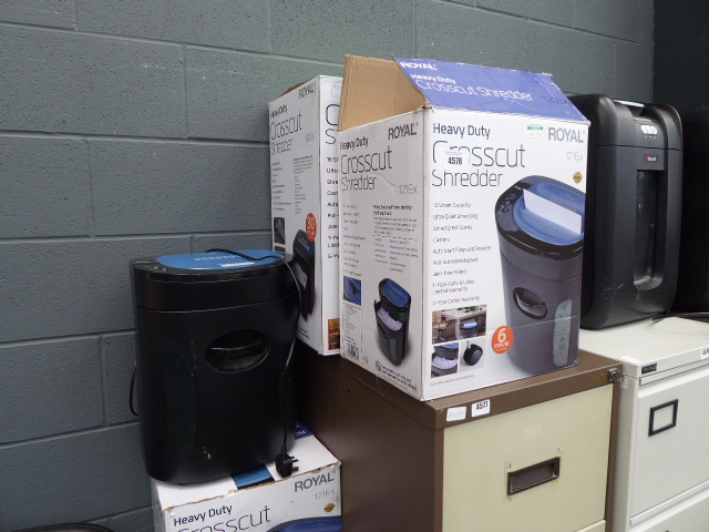 3 boxed and another unboxed Royal paper shredders