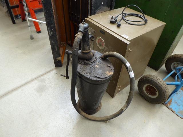 Vintage oil pump container