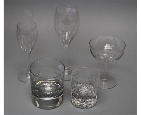 A collection of crystal and cut glass table glassware including Baccarat, Waterford and others (3 shelves)