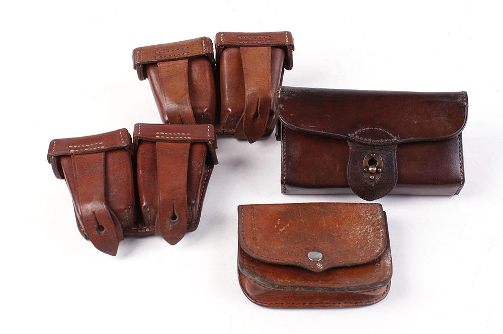 Lot 35 - Four leather ammunition pouches