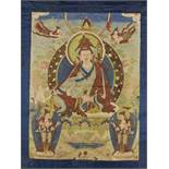 A PADMASAMBHAVA THANGKA EARLY 1800sTibet, circa 1800. Seated on a throne, his hands in varada- and