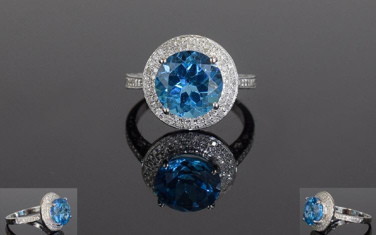 Lot 64 - 14ct White Gold Blue Topaz & Diamond Rin
