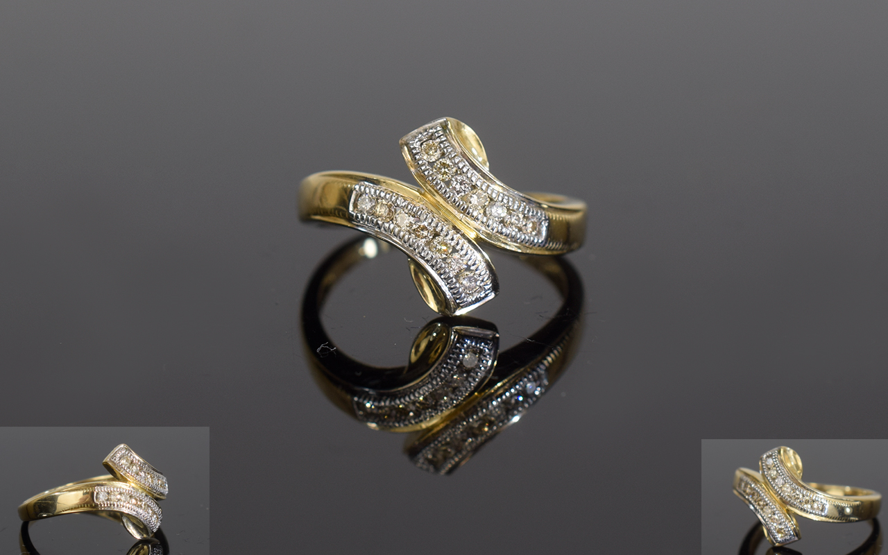 Lot 153 - Ladies 9ct Gold Twin Channel Set Diamond