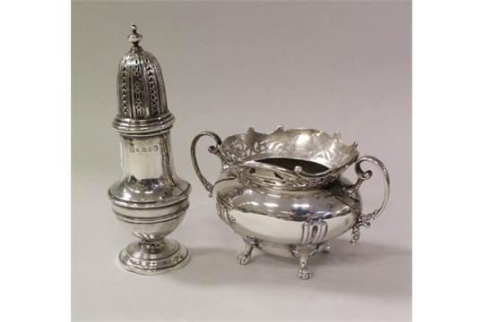 A George V silver twin-handled sugar bowl with pierced decoration,