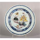 "An 18th century London delft polychrome plate with water lily decoration, 8 3/4"" dia, c1750"