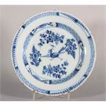 An 18th century English delft plate with chinoiserie strutting bird and flowers decoration, 9""