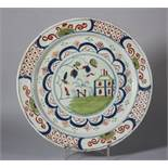 "An 18th century English delft charger with building and grass decoration, 11 5/8"" dia (restored)"