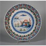 An 18th century English delft polychrome shallow lobed bowl with boat and fisherman in landscape