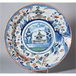 An 18th century Bristol delft charger with pagoda and landscape decoration and insect border, 13""
