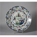 "An 18th century English delft charger with flying bird and flowers decoration, 11 1/2"" dia ("