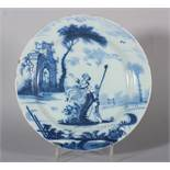 An 18th century Lambeth delft plate with shepherd and shepherdess in landscape and distant arch