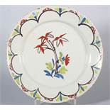 "An 18th century English delft plate with polychrome bamboo centre, 8 7/8"" dia (stabilised crack)"
