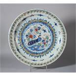 "An 18th century Bristol? delft charger with peacock decoration, foot rim with two holes, 13"" dia ("