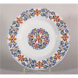 "An 18th century Scottish/Lambeth? delft polychrome plate with geometric floral decoration, 9"" dia ["
