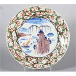 An 18th century English delft plate with polychrome landscape with rock and boat decoration and ""