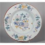 An 18th century Liverpool delft plate line drawn precious objects decoration and peony borders, 10