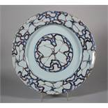 "An 18th century London delft charger with cracked ice centre and border decoration, 11 3/4"" dia ("