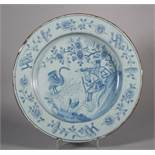 "An 18th century Liverpool delft charger with figures and a swan decoration, 11 7/8"" dia ("