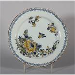 "An 18th century Lambeth delft polychrome plate with floral spray decoration, 8"" dia (hair crack)"