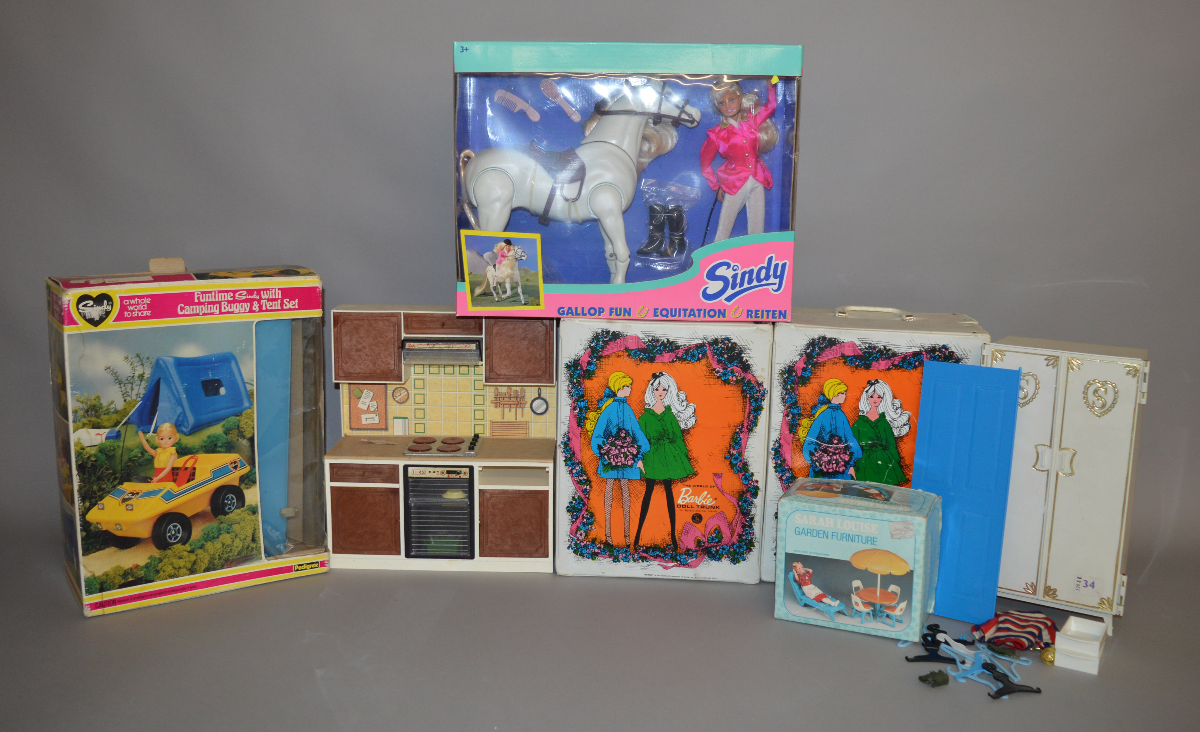 Lot 19 - EX-SHOP STOCK: Quantity of Fashion Doll accessories including a boxed Pedigree Sindy Camping Buggy
