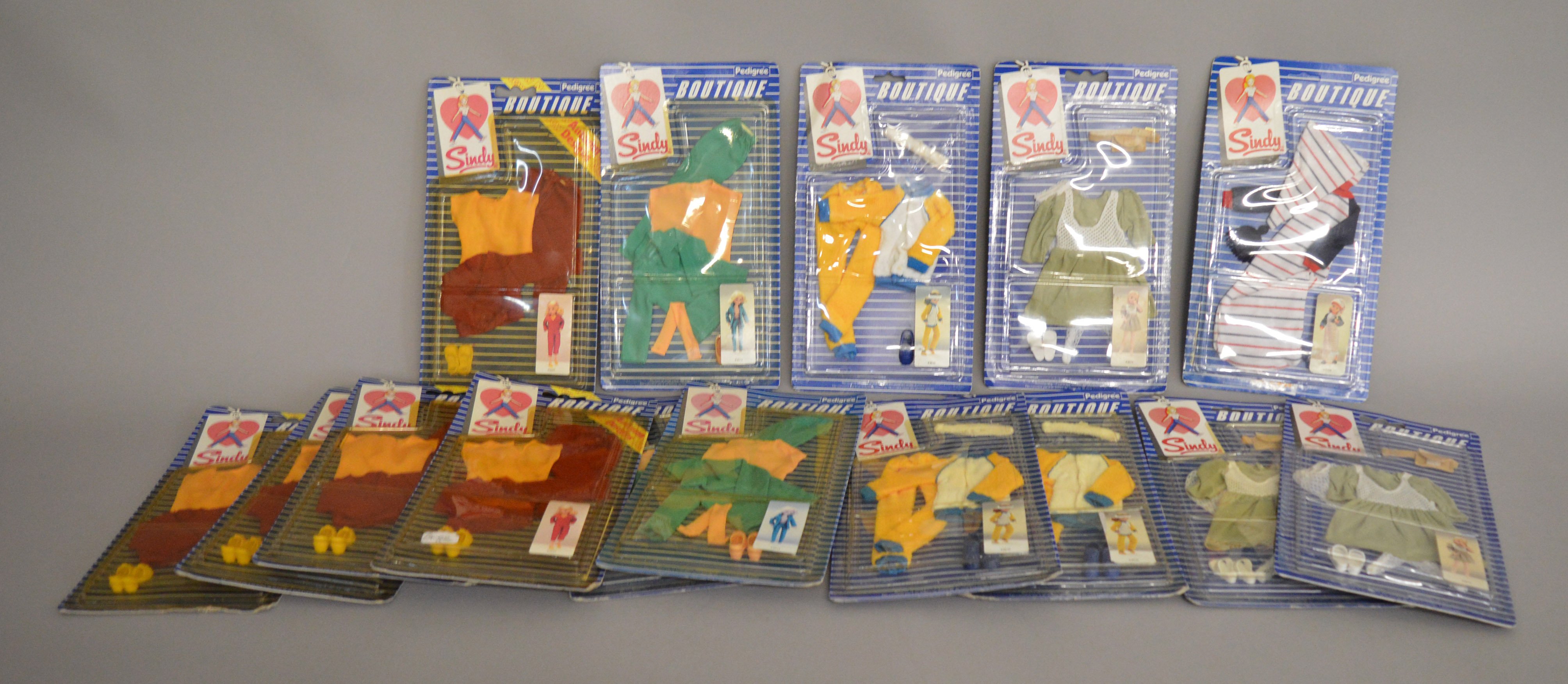 Lot 38 - EX-SHOP STOCK: Fifteen Pedigree Sindy doll Boutique outfit clothing accessory sets (15).