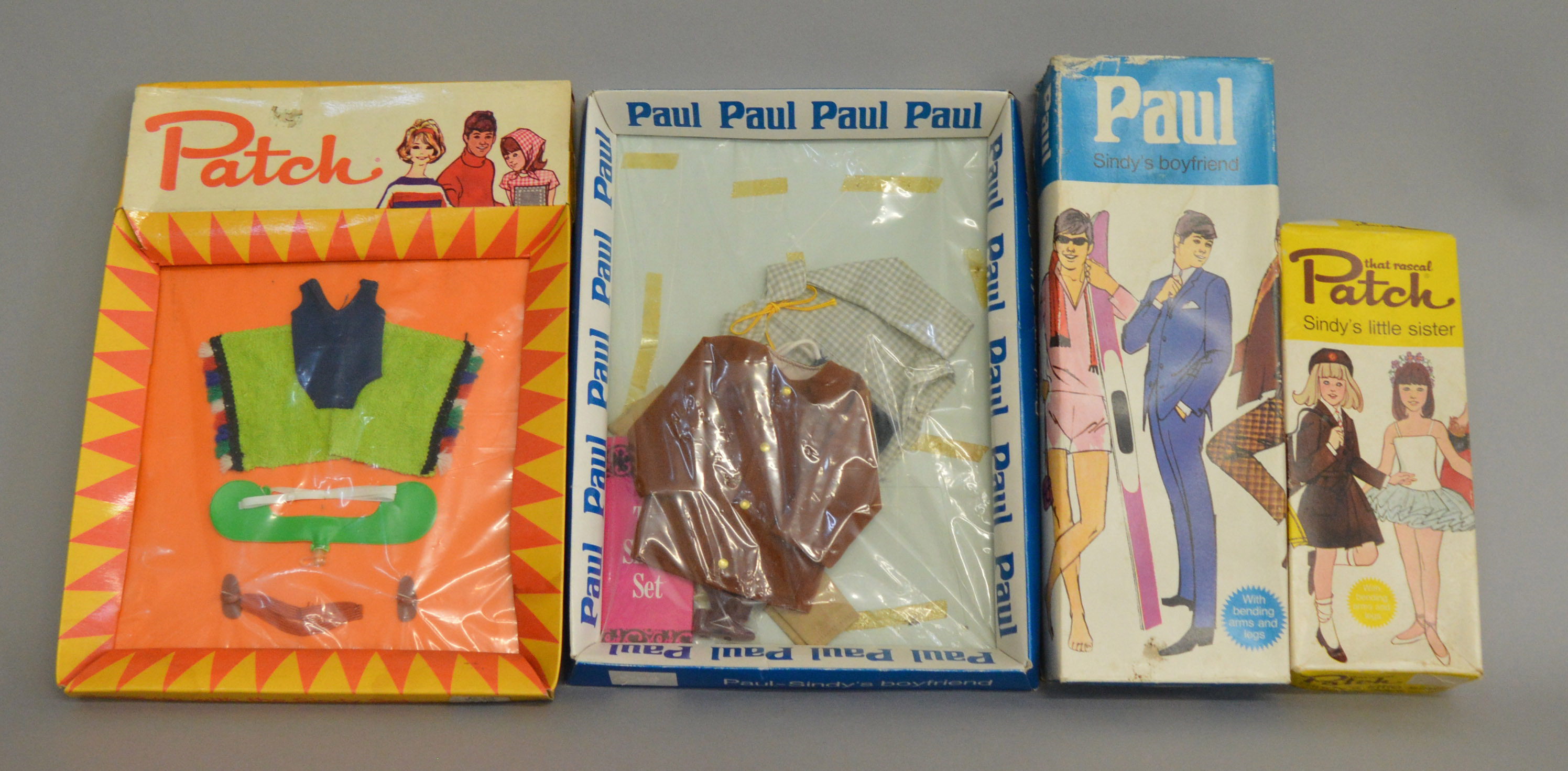 Lot 30 - EX-SHOP STOCK: Paul doll in original box along with Paul outfit set and Patch outfit set,