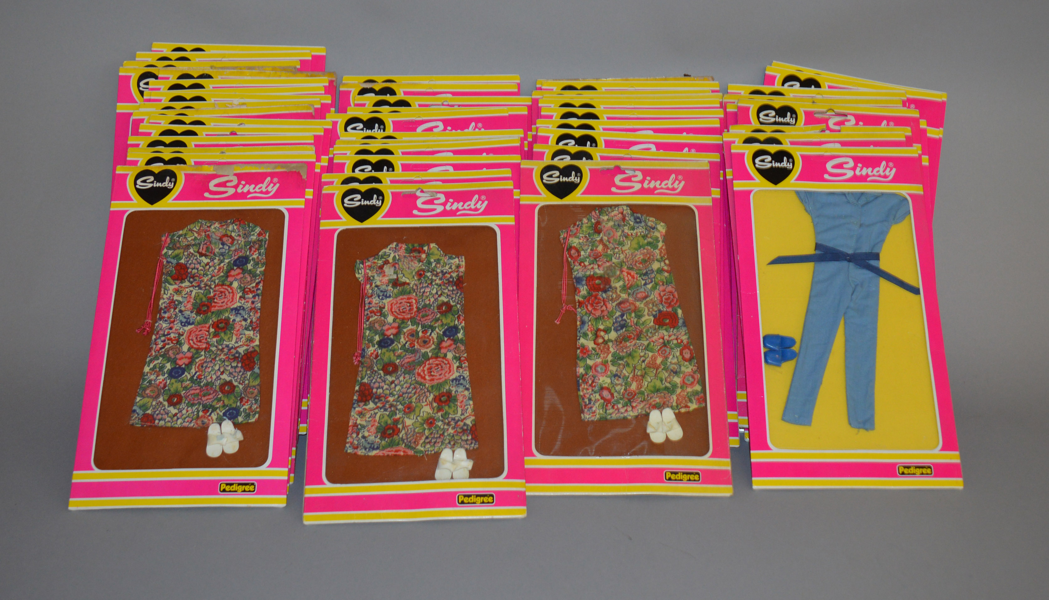 Lot 13 - EX-SHOP STOCK: Forty seven Pedigree Sindy doll clothing and outfits, includes #44120 and #44125,
