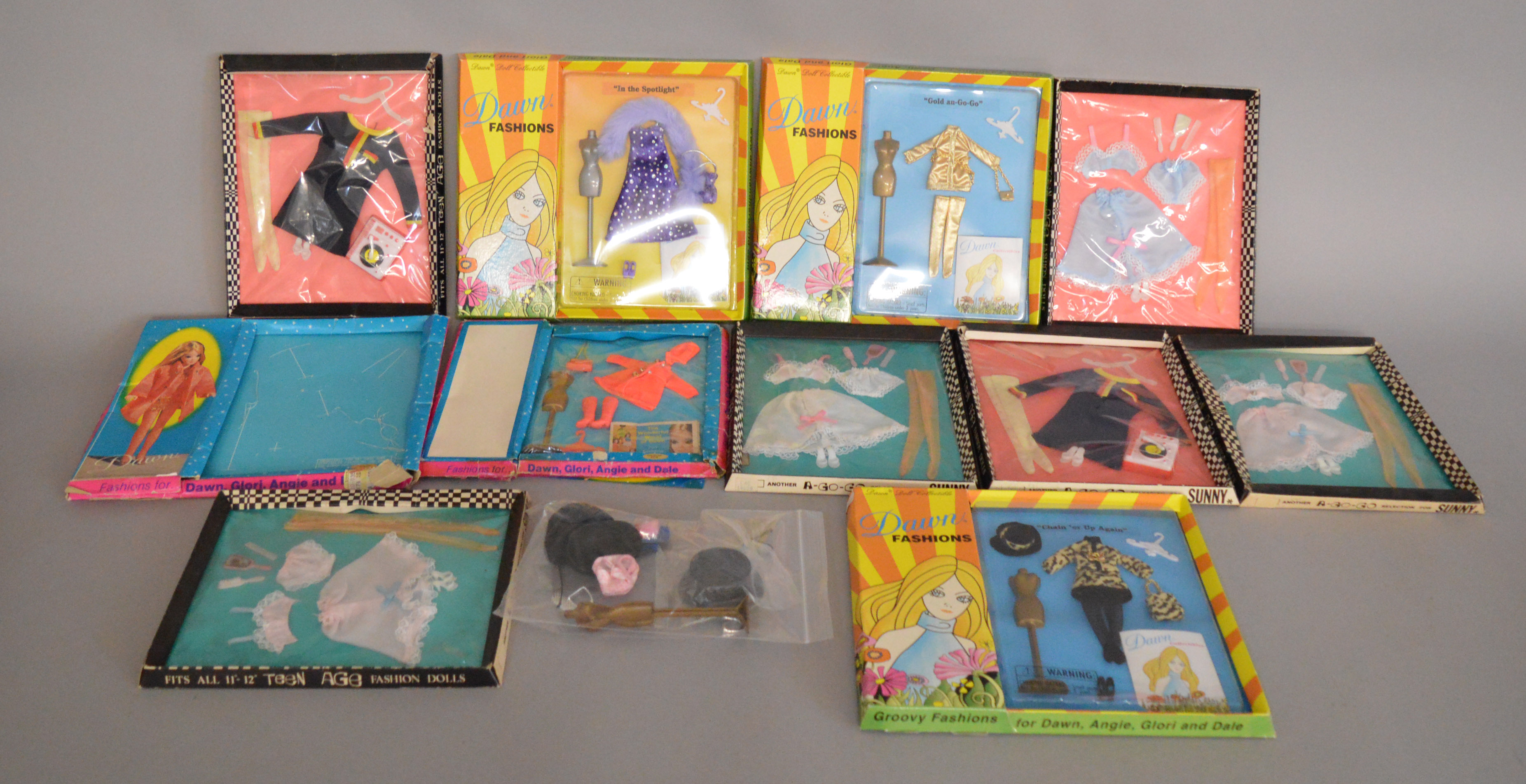 Lot 43 - EX-SHOP STOCK: Ten Fashion Doll Outfit clothing sets including Dawn Fashions and examples for Sunny