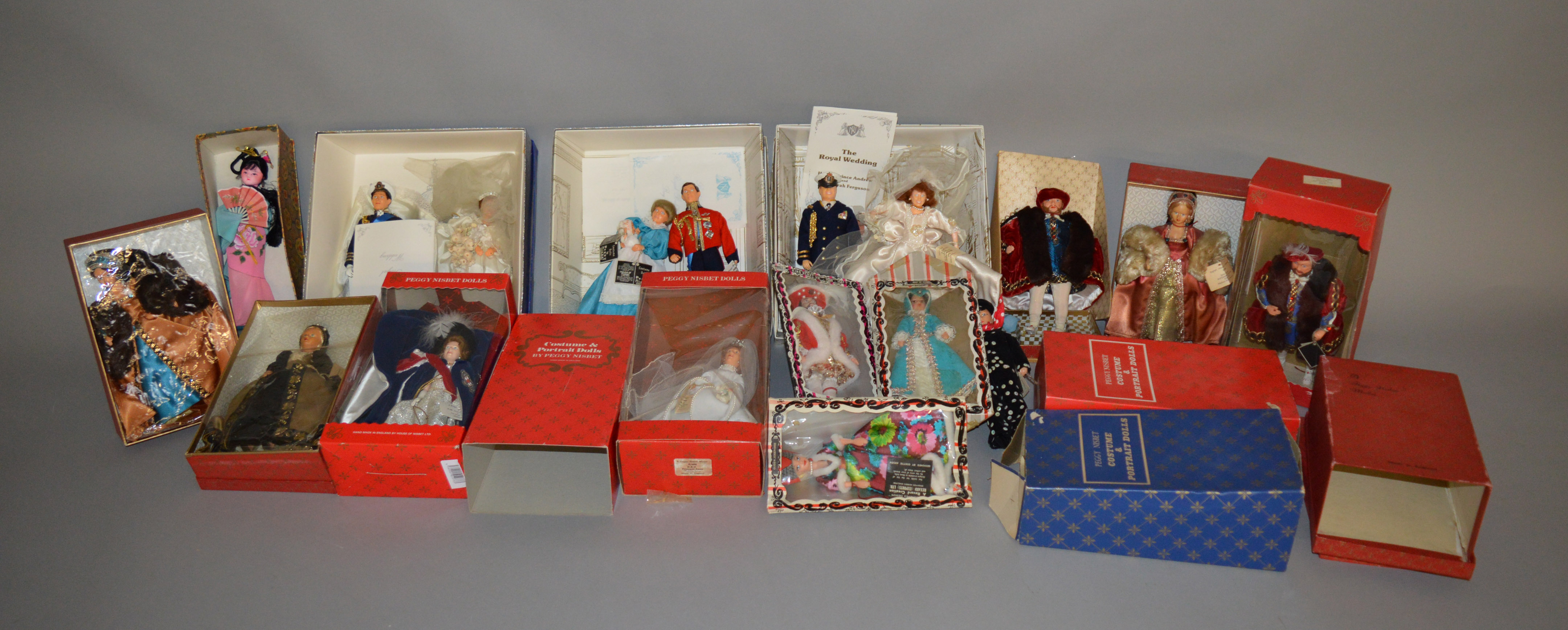 Lot 51 - EX-SHOP STOCK: Twelve boxed assorted Peggy Nisbett costume dolls,