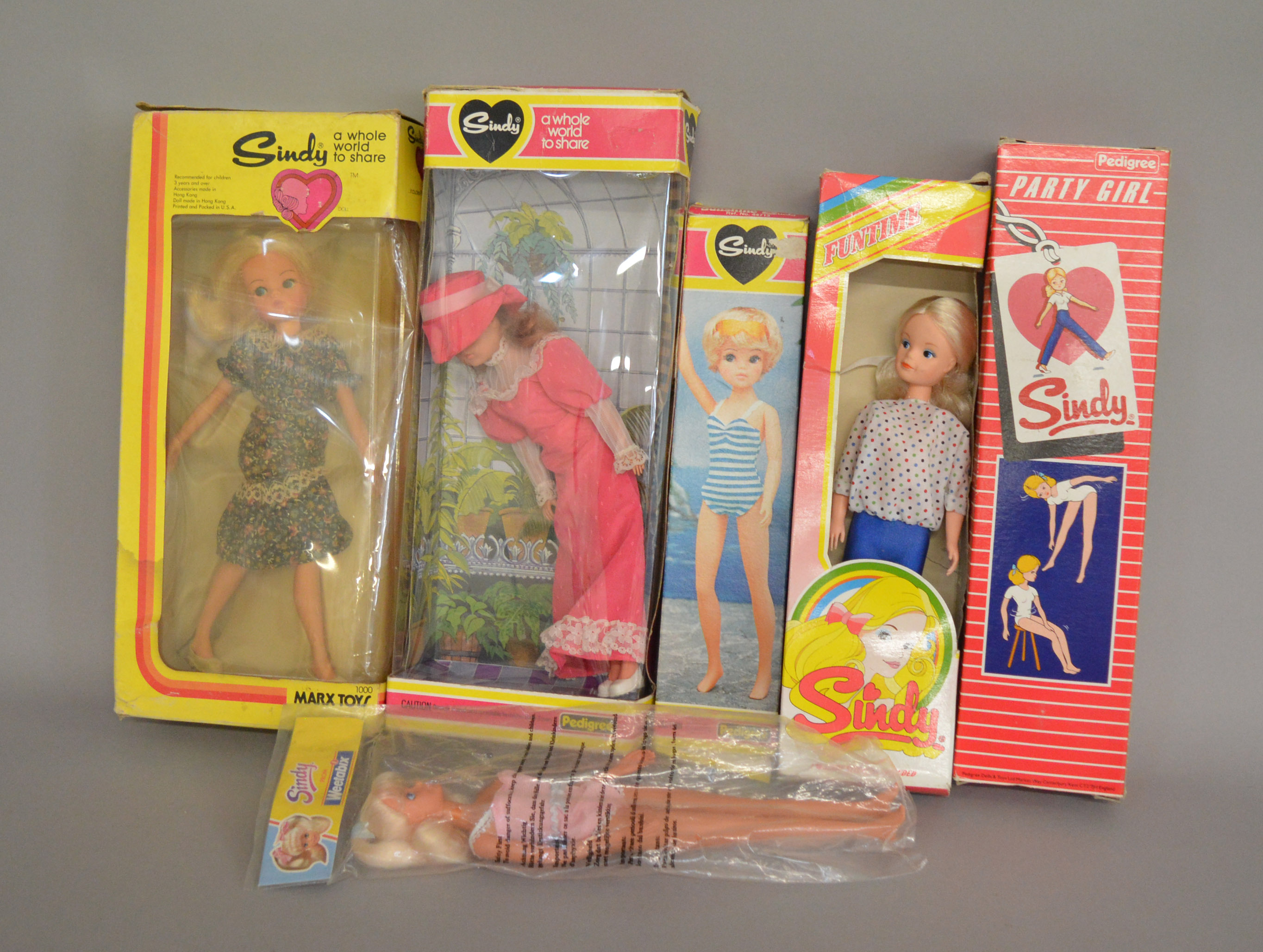 Lot 33 - EX-SHOP STOCK: Five Pedigree Sindy Fashion Dolls together with a Marx Toys example,