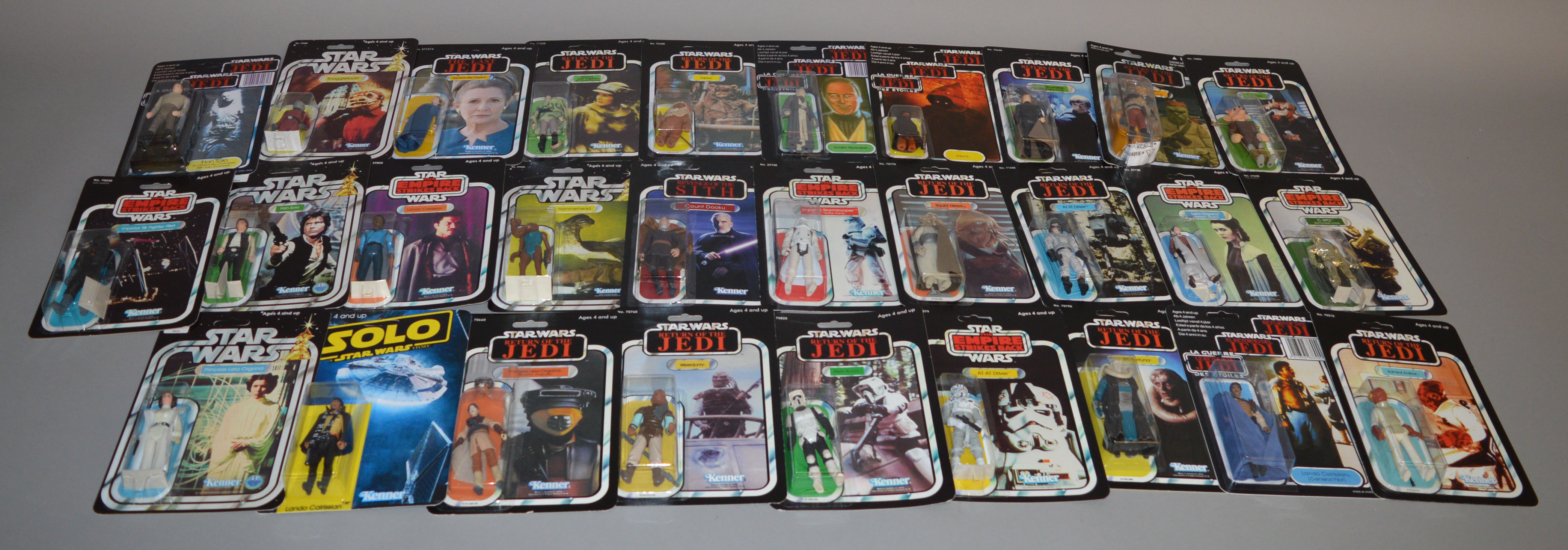 Lot 3 - Thirty two Star Wars figures by Kenner on reproduction cards,