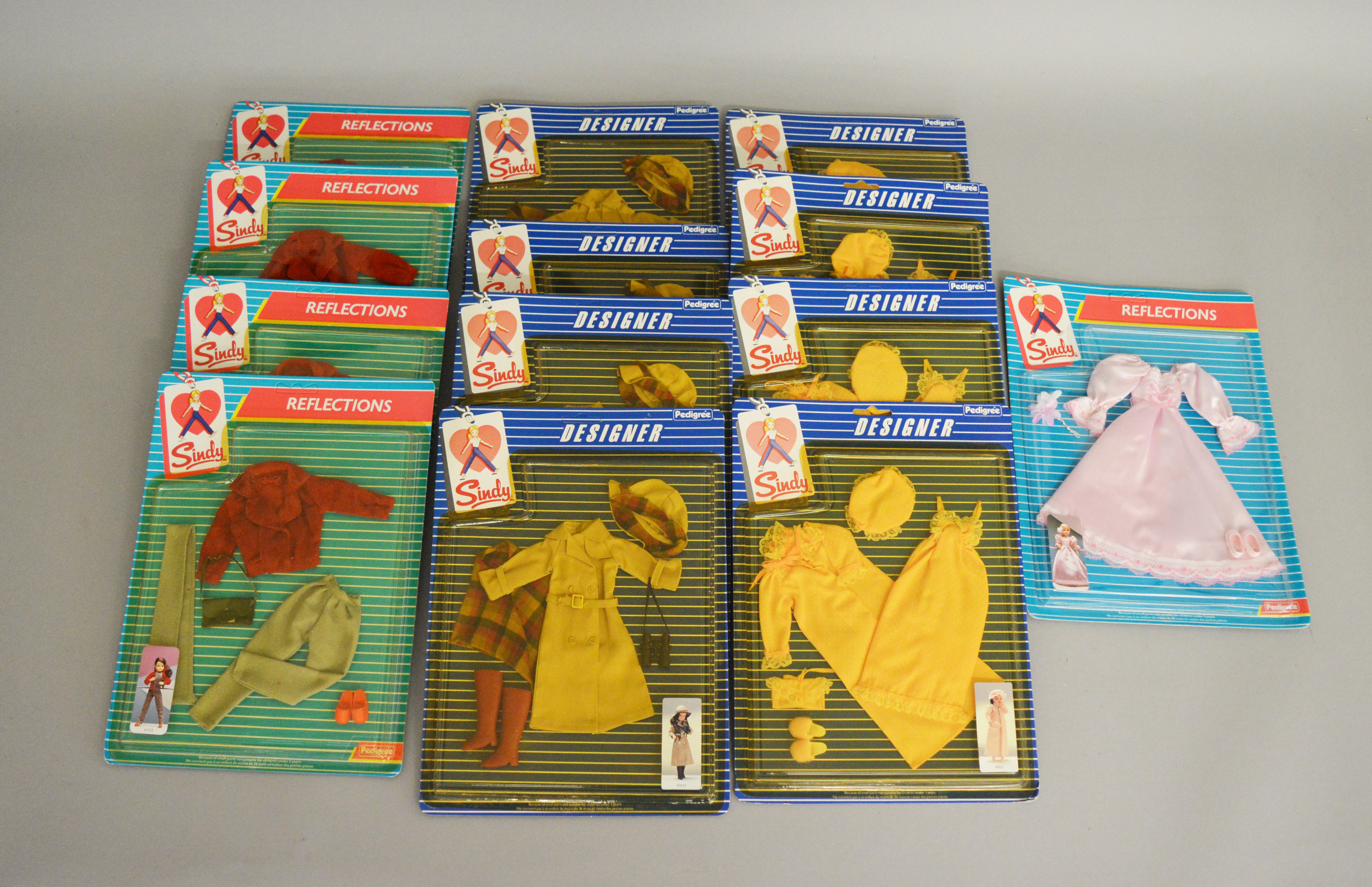 Lot 55 - EX-SHOP STOCK: Thirteen Pedigree Sindy doll Outfit clothing accessory sets including Designer and