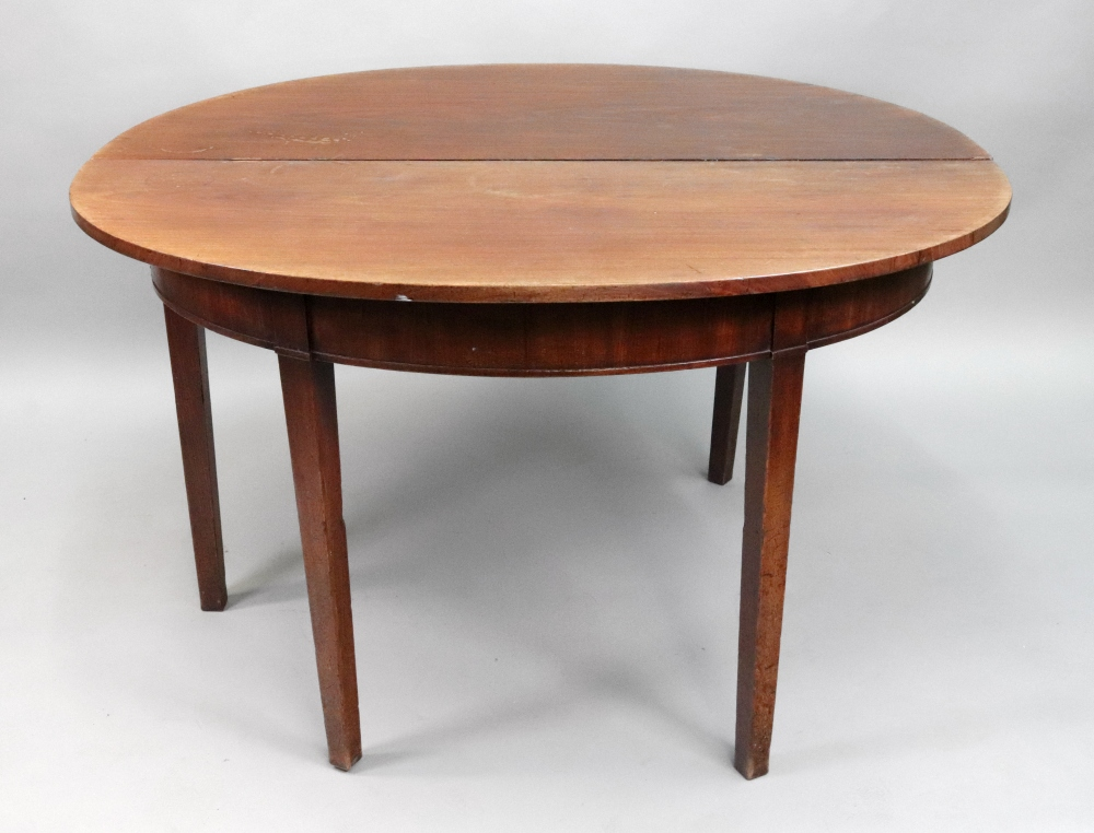 A George III mahogany dining table, with