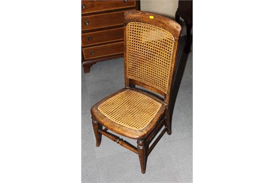 A Victorian Wooden Nursing Chair With Caned Seat And Back And A Long  Footstool With Caned Top, On