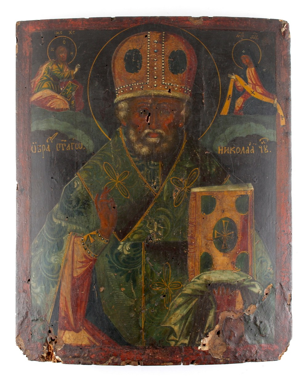 Lot 202 - Property of a deceased estate - a Russian icon of St. Nicholas, depicted wearing a jewelled hat,