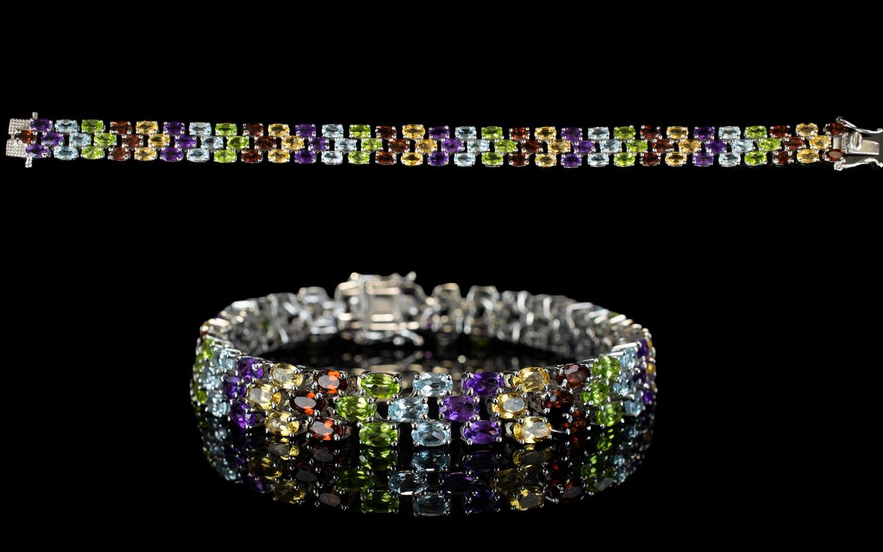 Lot 155 - Multi Gemstone Three Row Line Bracelet,