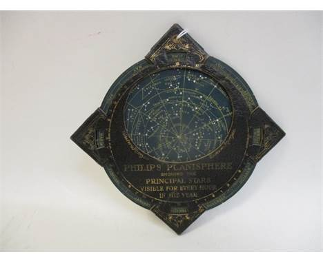 """A Philips Planisphere astronomical star chart in tooled, gilt, black leather and card, 4 1/2"""" sq"""