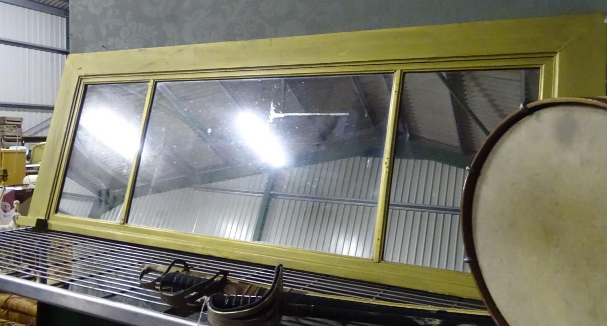 A gilt over mantel mirror,