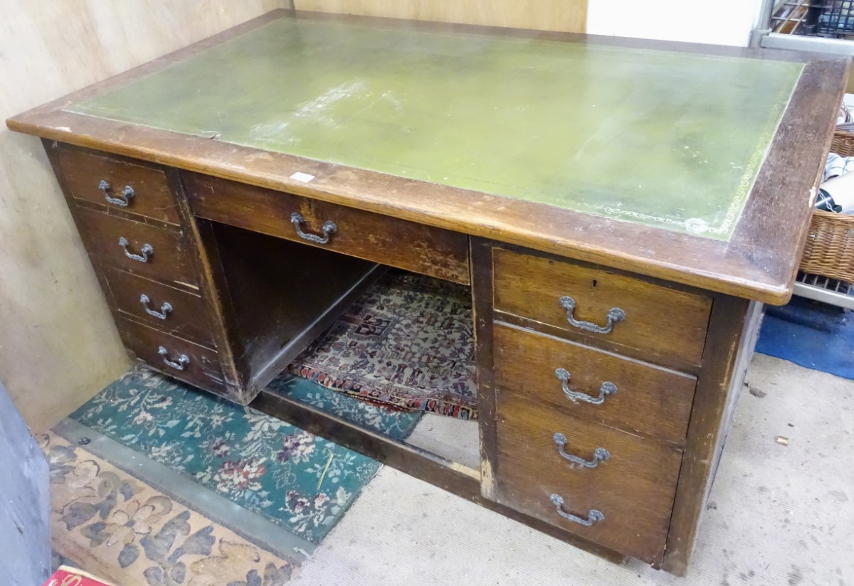 A 1950s desk with green leather insert to top CONDITION: Please Note - we do not