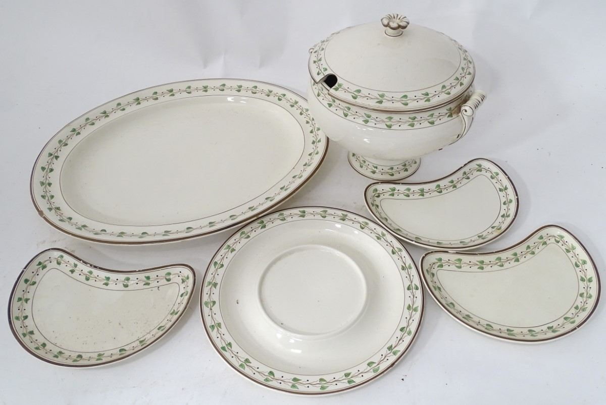 A quantity of creamware items comprising, soup tureen and stand, large meat plate etc.
