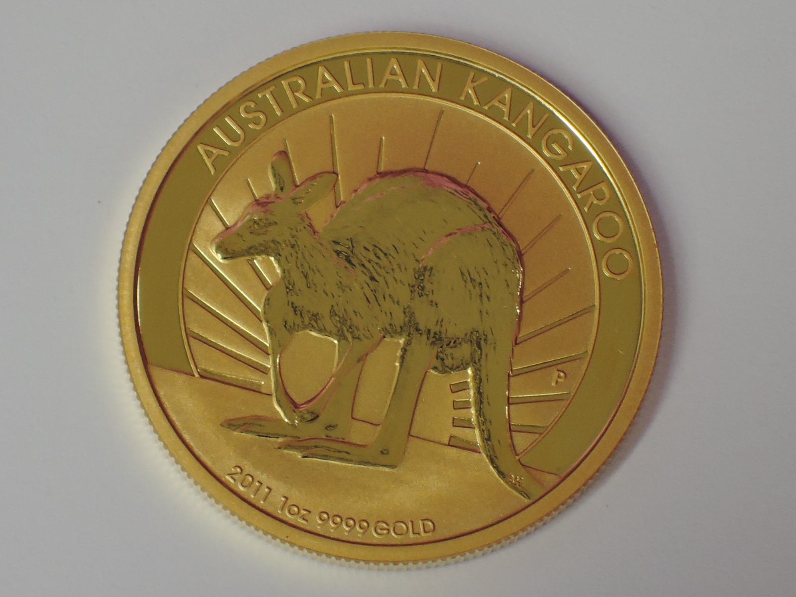 Lot 604 - A gold 1oz 2011 100 dollar Australian Kangaroo coin, in plastic case