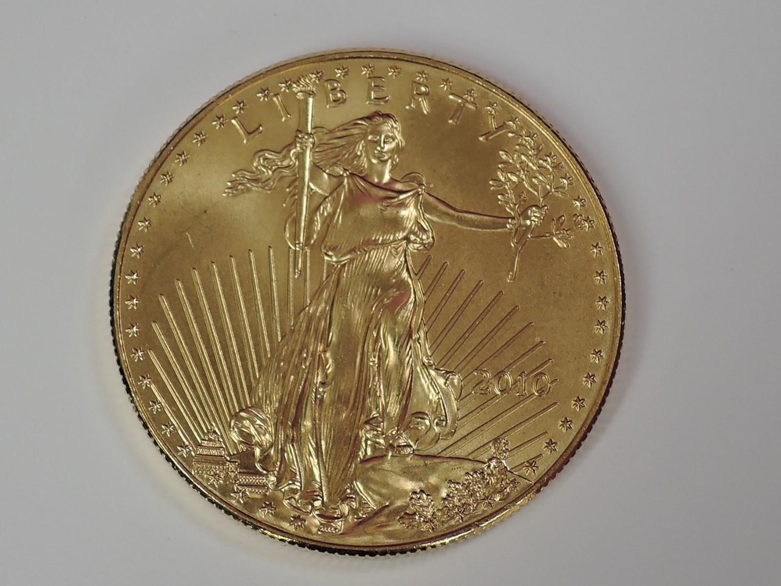 Lot 614 - A gold 1oz 2010 50 dollar U.S.A. coin, in plastic case