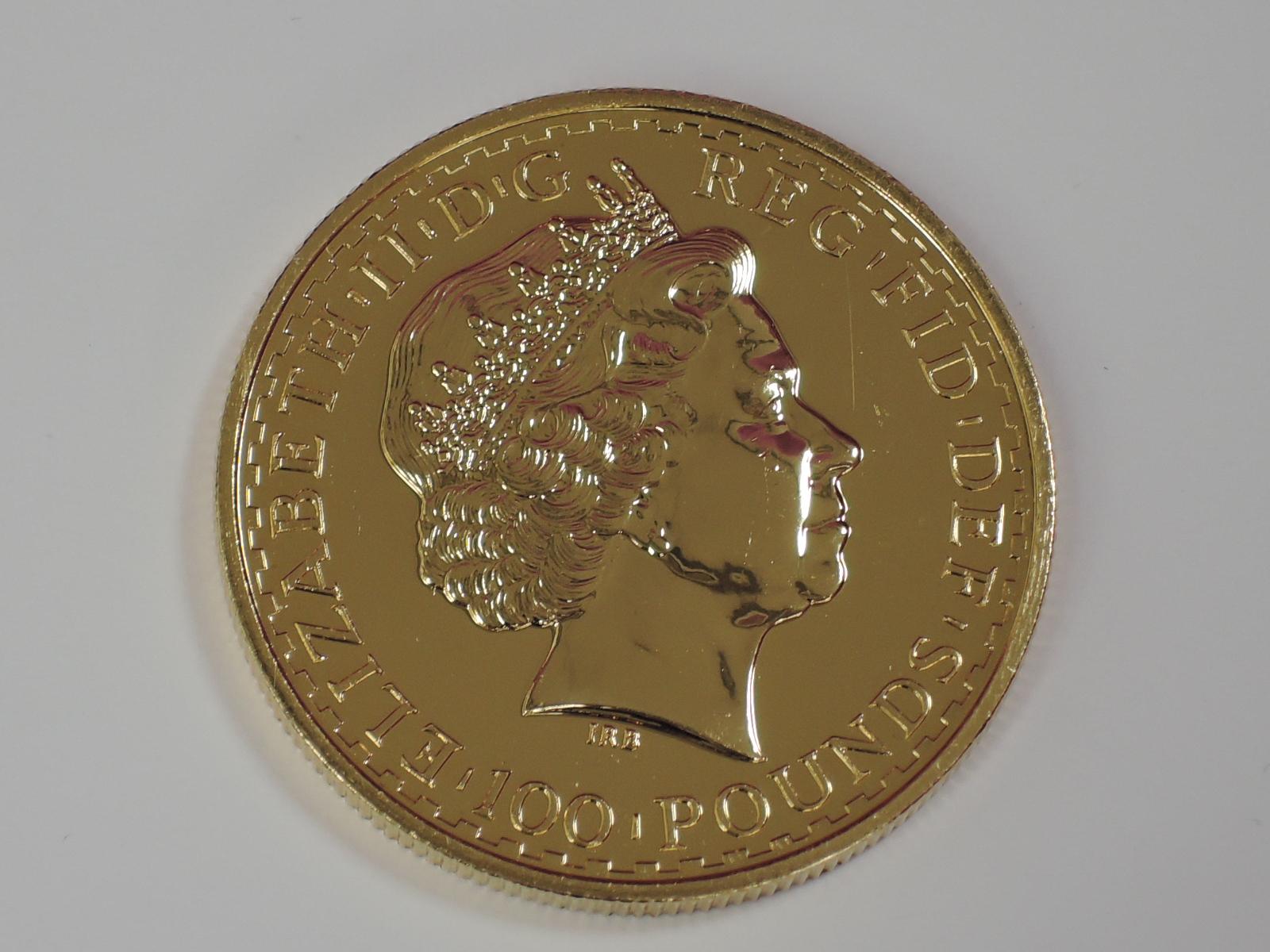 Lot 636 - A gold 1oz 2003 Great Britain Britannia 100 pound coin, in plastic case